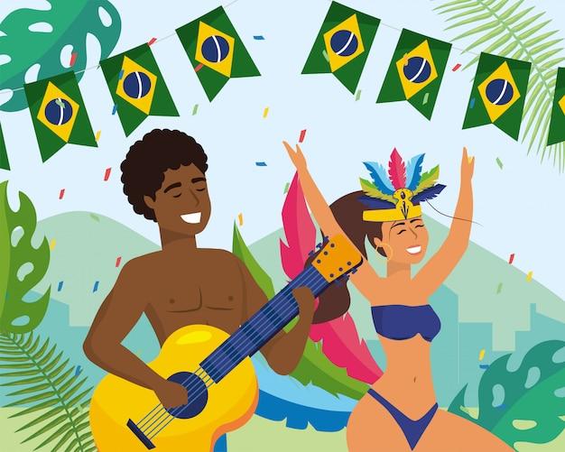 Mężczyzna i dziewczyna tancerze z gitarą i kostiumem