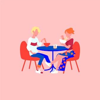Mężczyzna i kobieta jedzą ramen na randce.