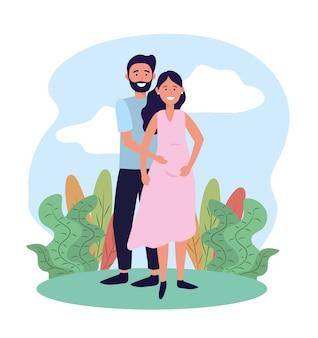 Mężczyzna i kobieta para w ciąży z roślinami