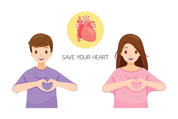 Mężczyzna i kobieta pokazujący gest dłoni w kształcie serca na lewej piersi