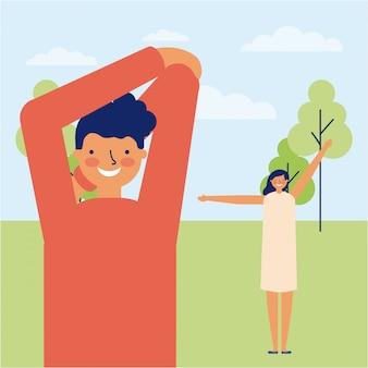 Mężczyzna i kobieta robi ćwiczeniu plenerowemu