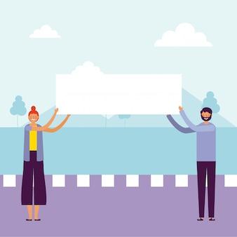 Mężczyzna i kobieta trzymając transparenty