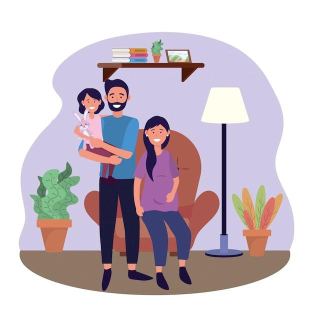 Mężczyzna i kobieta w ciąży na krześle z córką