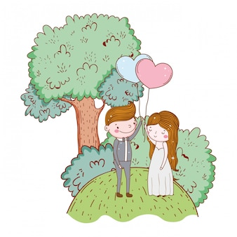 Mężczyzna i kobieta z sercem balon i drzewo