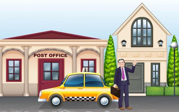 Mężczyzna i taksówka przed pocztą