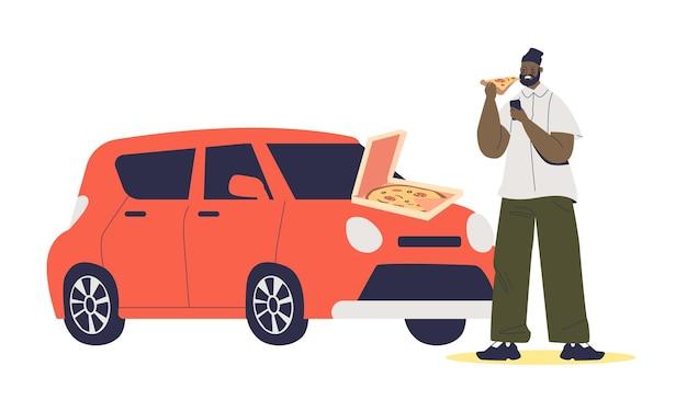 Mężczyzna jedzenie pizzy w masce samochodu na białym tle