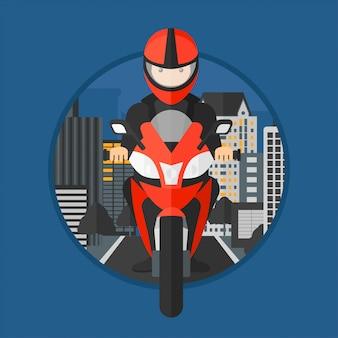 Mężczyzna jedzie motocykl.
