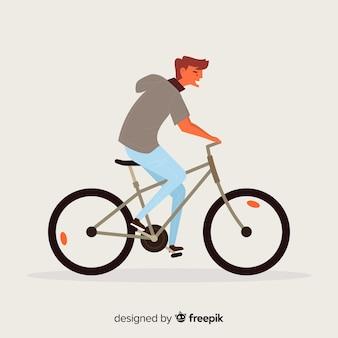 Mężczyzna jedzie na roweru tle