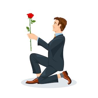 Mężczyzna klęczy z kwiatem.