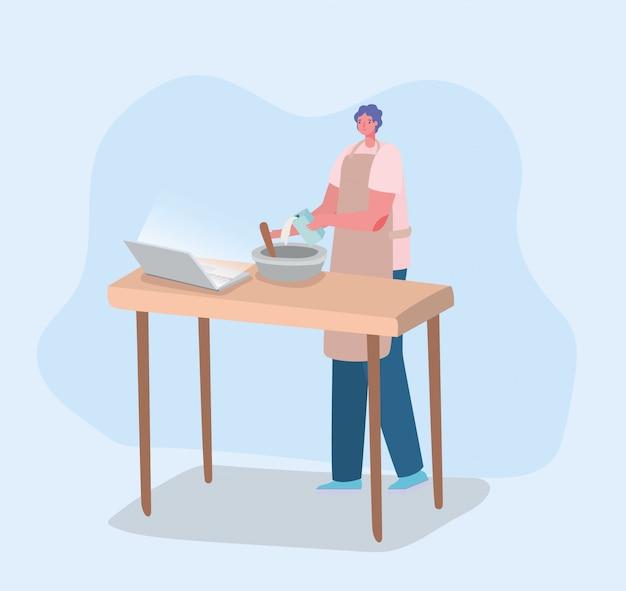 Mężczyzna kucharstwo przed laptopem