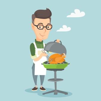 Mężczyzna kulinarny kurczak na grilla grillu.