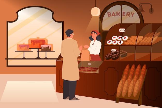 Mężczyzna kupuje jedzenie w piekarni. wnętrze budynku piekarni. lada sklepowa z witryną pełną wypieków.