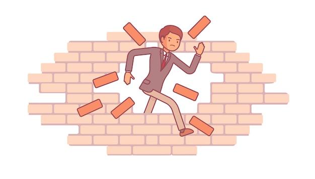 Mężczyzna łama ściana z cegieł
