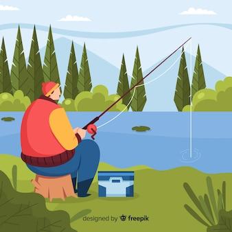 Mężczyzna łowi przy jeziorem