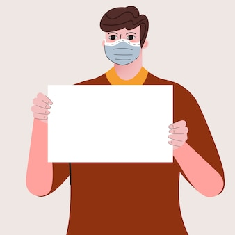Mężczyzna ma na sobie maskę i trzyma tabliczkę