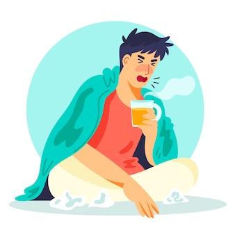 Mężczyzna ma przeziębienie i trzyma filiżankę herbaty