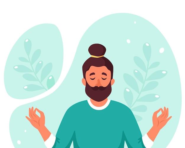 Mężczyzna medytuje. zdrowy tryb życia