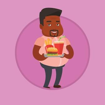 Mężczyzna mienia taca pełno fast food.