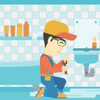 Mężczyzna naprawia zlew.