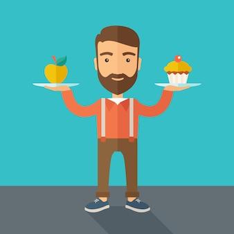 Mężczyzna niesie ze sobą dwie ręce babeczki i jabłka.