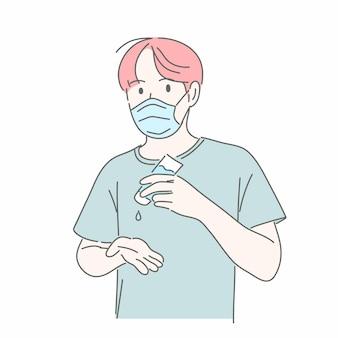 Mężczyzna nosi maskę medyczną i używa żelu alkoholowego do mycia rąk.