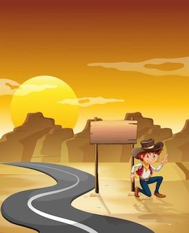 Mężczyzna obok pustej tablicy przy drodze