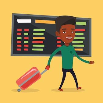 Mężczyzna odprowadzenie z walizką przy lotniskiem.