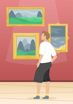 Mężczyzna patrzy na obrazy znanych artystów. muzeum sztuk pięknych. sztuka klasyczna
