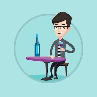 Mężczyzna pije wino w restauraci.