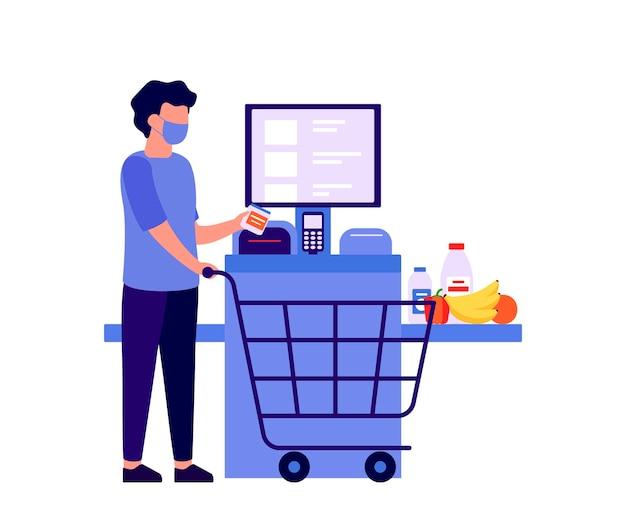 Mężczyzna płaci za produkty na urządzeniu elektronicznym