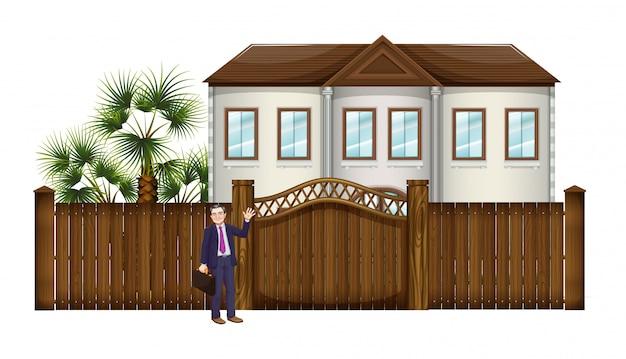 Mężczyzna pokazujący duży dom
