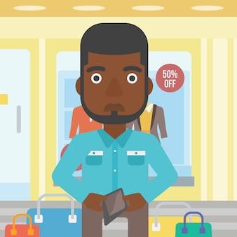Mężczyzna pokazuje epmty portfel