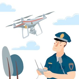 Mężczyzna policjant, policjant obsługujący latającego drona z pilotem zdalnego sterowania