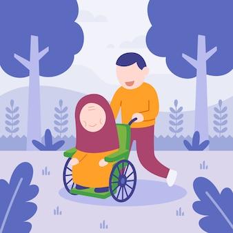 Mężczyzna pomaga jej mamie na wózku inwalidzkim