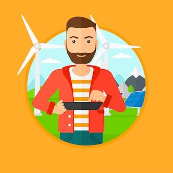 Mężczyzna pracownik elektrowni słonecznej i farmy wiatrowej.