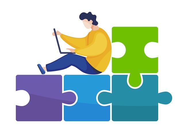 Mężczyzna pracujący na laptopie siedzi na krześle abstrakcyjne puzzle