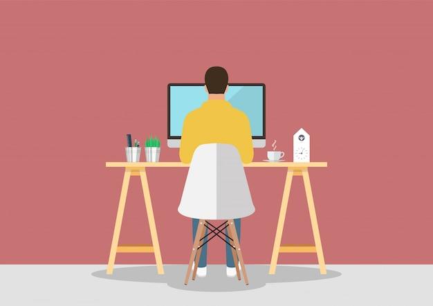 Mężczyzna pracuje na komputerze w nowoczesnym stylu pracy