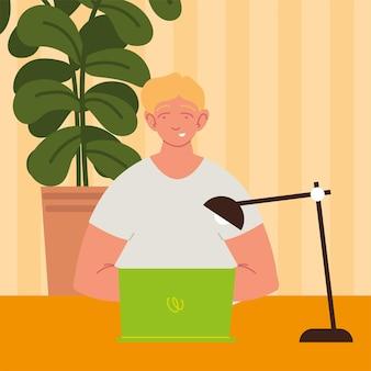 Mężczyzna pracuje w domu z laptopem