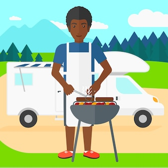 Mężczyzna przygotowuje grilla.