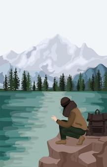 Mężczyzna relaksuje się na świeżym powietrzu w naturalnym krajobrazie