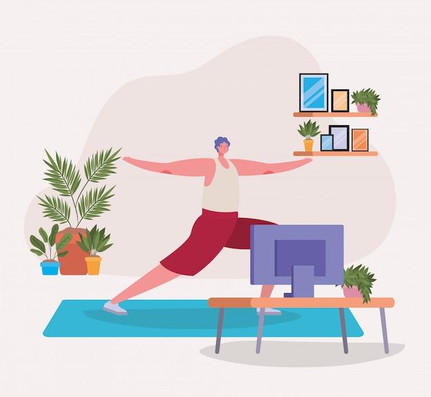 Mężczyzna robi joga na macie przed tv