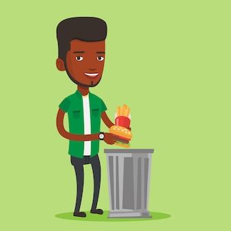 Mężczyzna rzuca fast foodów.