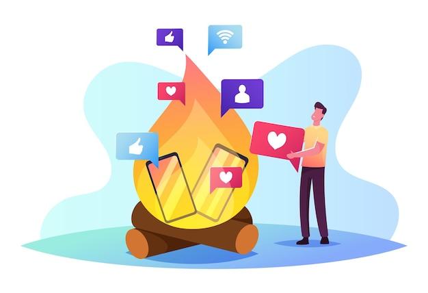 Mężczyzna rzuca gadżetami w ogniu odmawiaj uzależnienia od telefonu i internetu, spędzając wolny czas offline