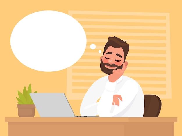 Mężczyzna siedzący przy biurku marzy o czymś.