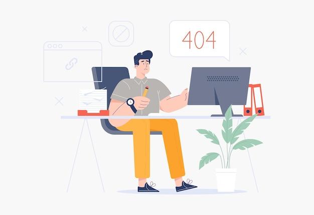 Mężczyzna siedzący przy komputerze przy stole roboczym