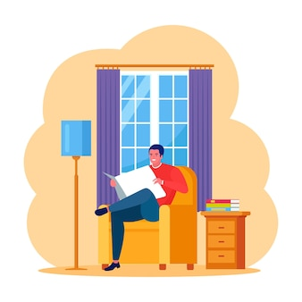 Mężczyzna siedzi na fotelu i czyta wiadomości