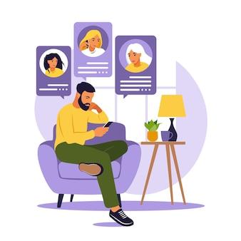 Mężczyzna siedzi na kanapie z telefonem. przyjaciele rozmawiają przez telefon. randkowa koncepcja aplikacji, aplikacji lub czatu. płaski styl. na białym tle.