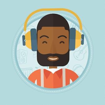 Mężczyzna słucha muzyka w hełmofonach