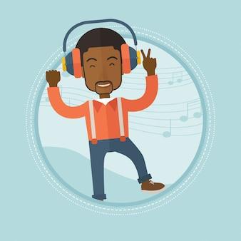 Mężczyzna słucha muzyki w hełmofonach i tanu