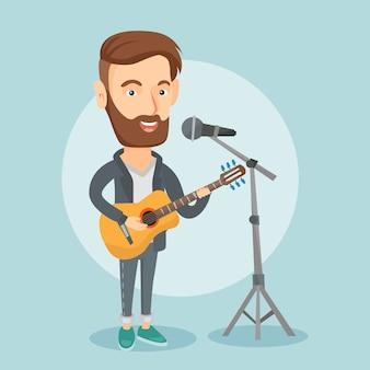 Mężczyzna śpiewa w mikrofonie i gra na gitarze.